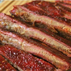low and slow smoked ribs on a cutting board