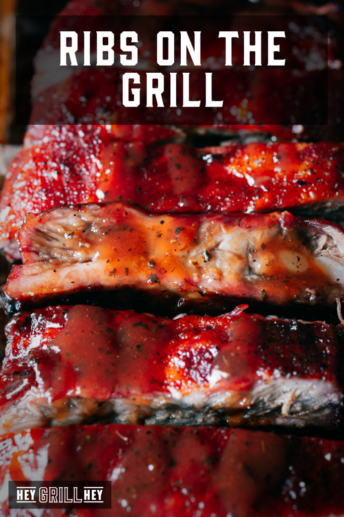 Sliced ribs stacked on a cutting board with text overlay - Ribs on the Grill.