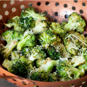 Garlic Parmesan grilled broccoli in a copper vegetable basket.