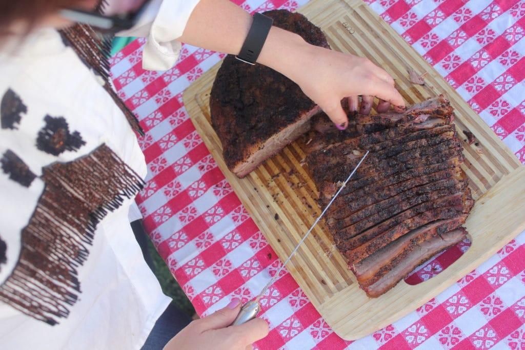 Brisket Flat Sliced on a wood cutting board.