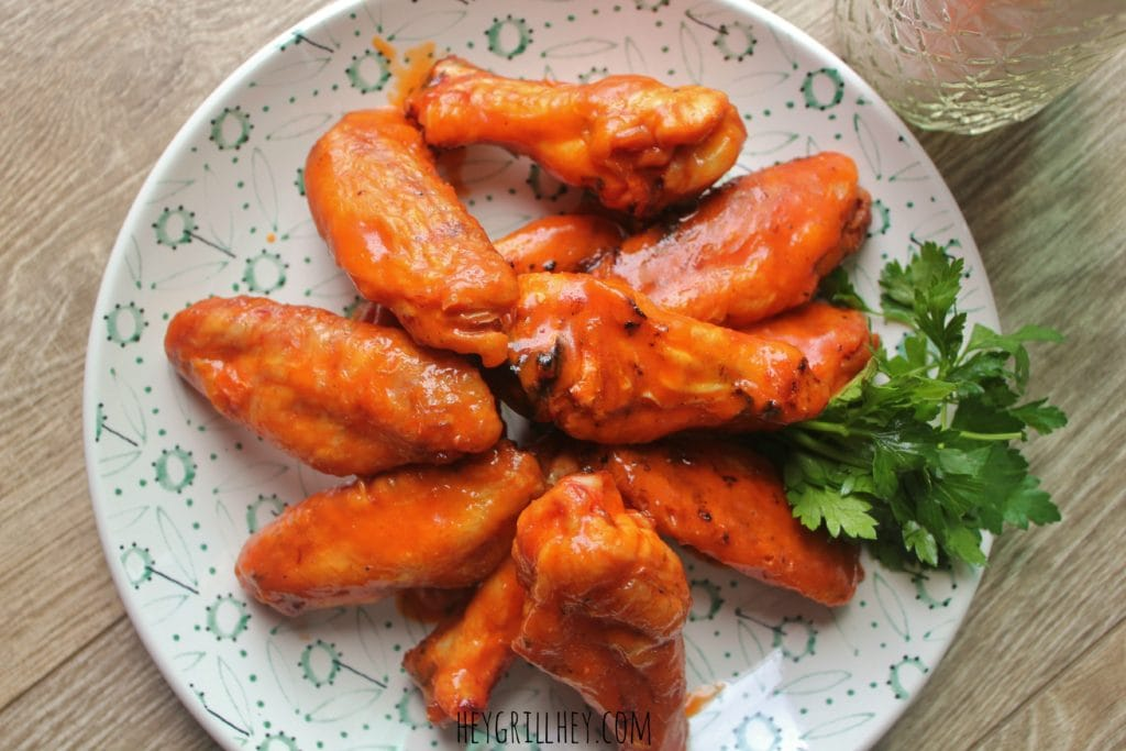 Ultimate Smoked Buffalo Chicken Wings top down on a white plate.