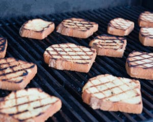 lemon cake slices directly on the grill grate inside the grill