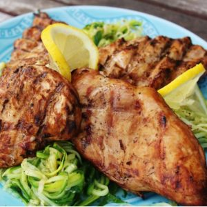 skinny grilled lemon chicken on a plate