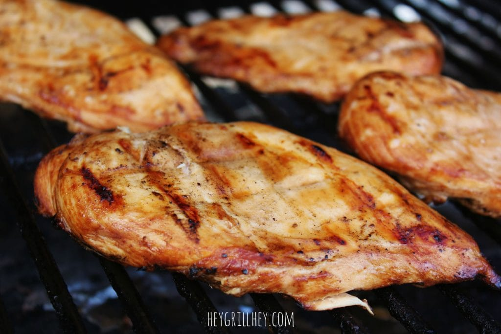 Marinated chicken cooking on a grill