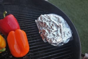 chopped beets wrapped tightly in aluminum foil, and placed on the grill grate in the grill.