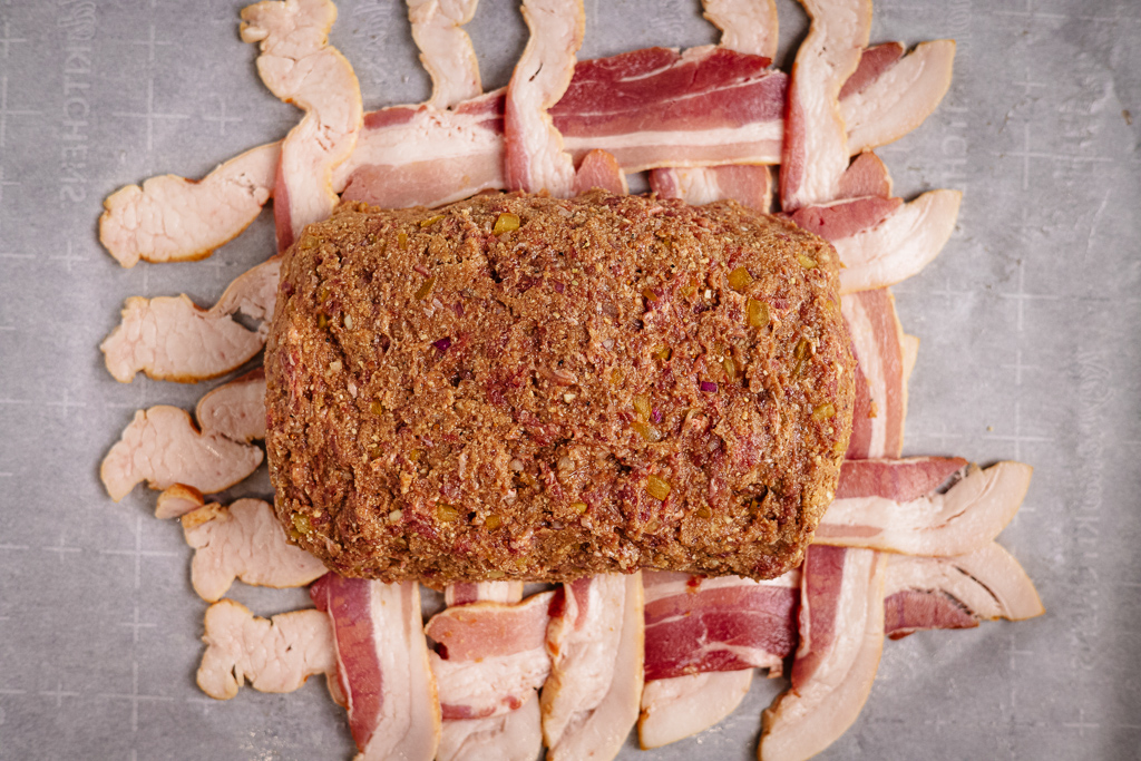 Formed BBQ meatloaf log over a bacon weave.
