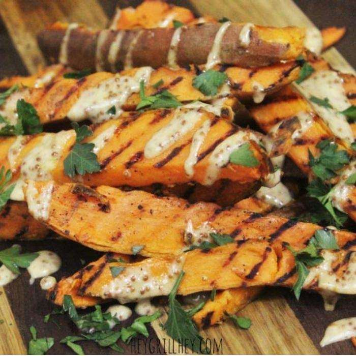 grilled sweet potato fries topped with honey mustard