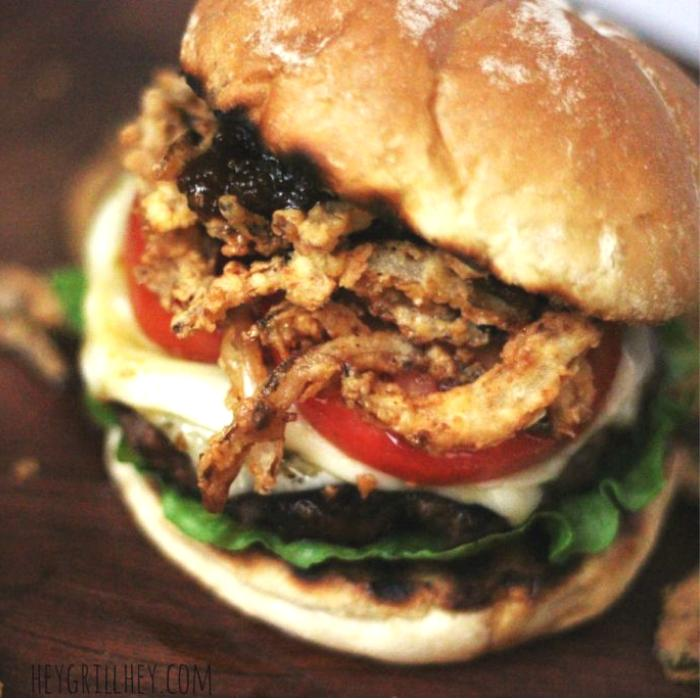 crispy bourbon burger with crispy onion straws