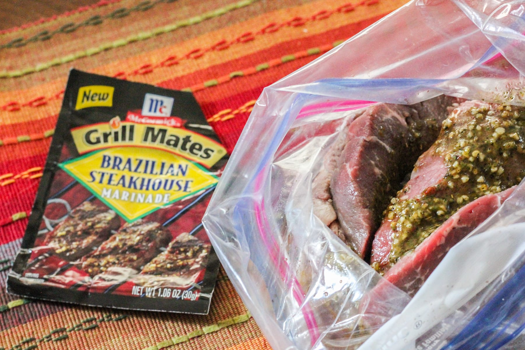 steak in a marinade bag next to a seasoning packet.
