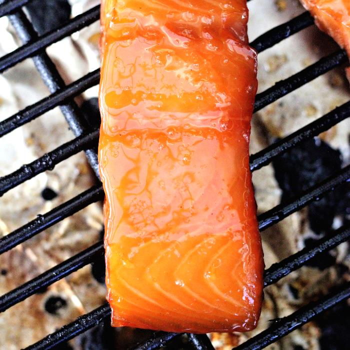 Smoked maple glazed salmon on the grill grates of a pellet smoker.