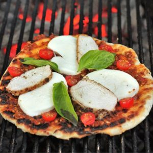 wood fired pizza with red pesto and grilled chicken