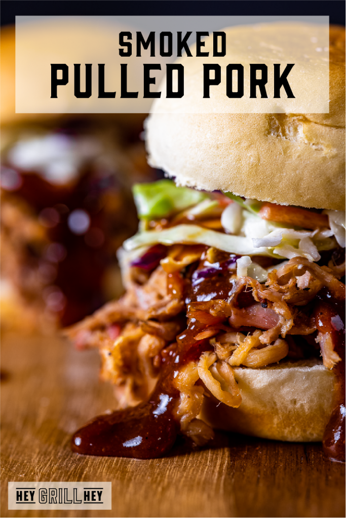 Smoked Pulled Pork Sandwich on a wooden cutting board. Text overlay reads: Smoked Pulled Pork.