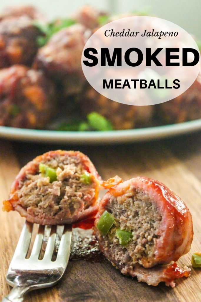 cheddar jalapeno smoked meatballs with a fork savagely stabbed through it.