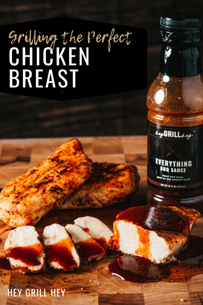 Sliced grilled chicken breast drizzled with Everything Sauce on a wooden cutting board with two whole grilled chicken breasts in the background. Text overlay reads: Grilling the Perfect Chicken Breast