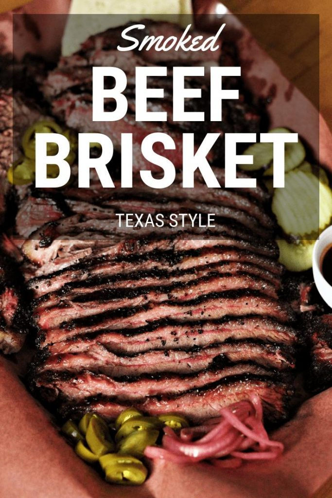 sliced texas style smoked beef brisket on peach butcher paper.