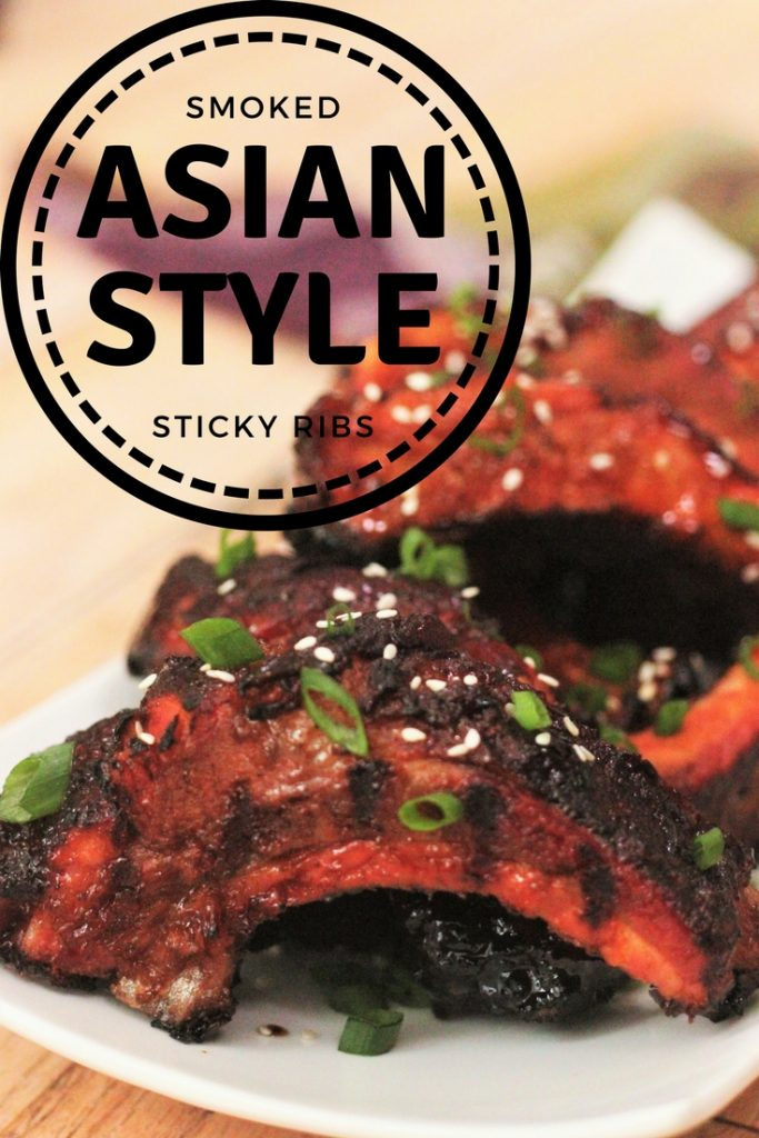 """Smoked Asian Style Sticky Ribs served on a white platter. Text overlay reads, """"Smoked Asian Style Sticky Ribs."""""""