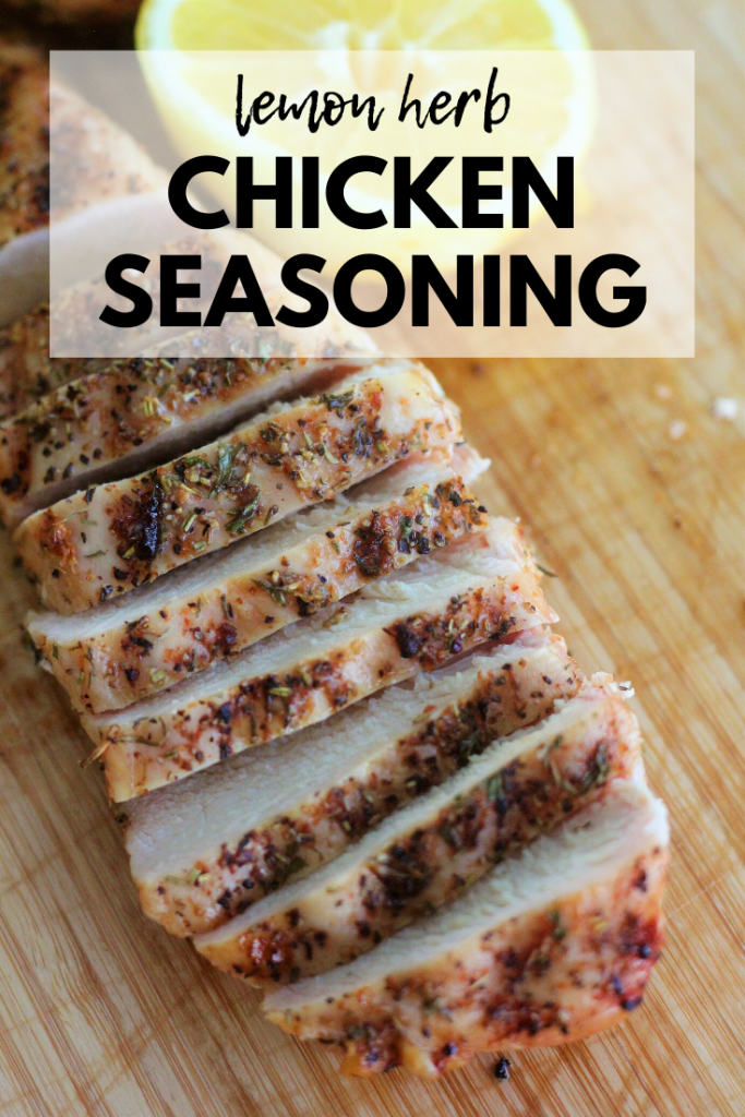 "Sliced and seasoned chicken breast on a wooden cutting board with half a lemon in the background. Text overlay: ""Lemon Herb Chicken Seasoning."""