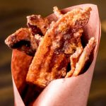 smoked candied bacon wrapped in butcher paper