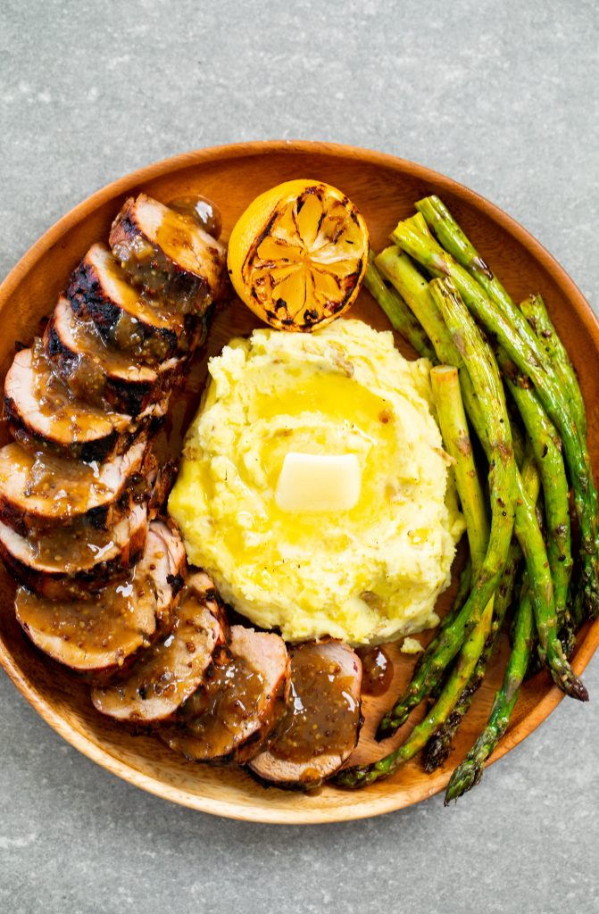 Grilled asparagus with smoked mashed potatoes and mustard glazed pork tenderloin.