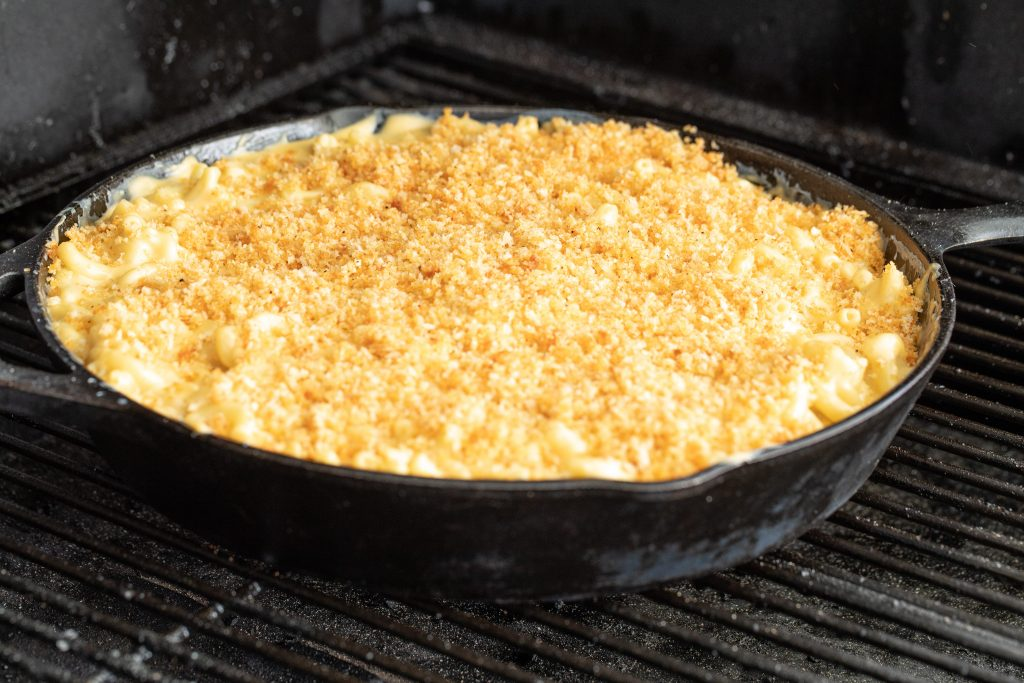 smoked mac and cheese in a skilled on the smoker.
