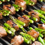 steak and asparagus kabobs on the grill