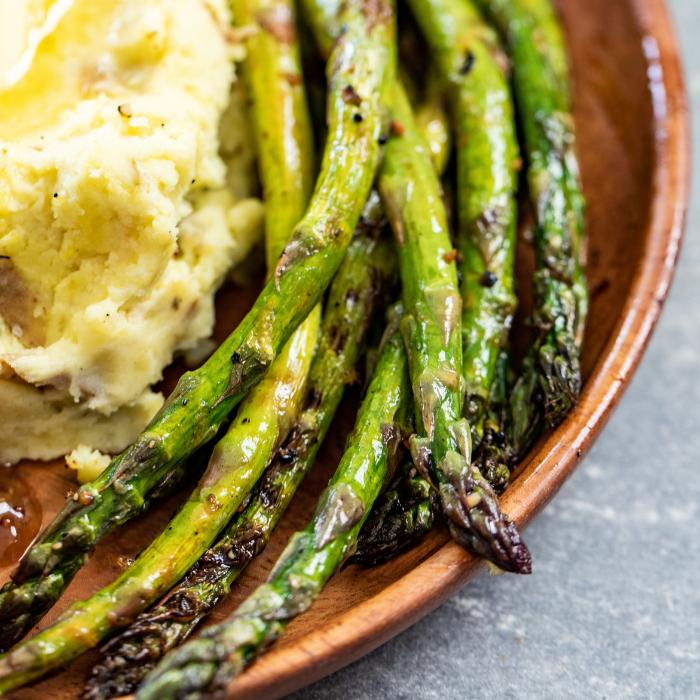 grilled asparagus in bowl with smoked mashed potaotes