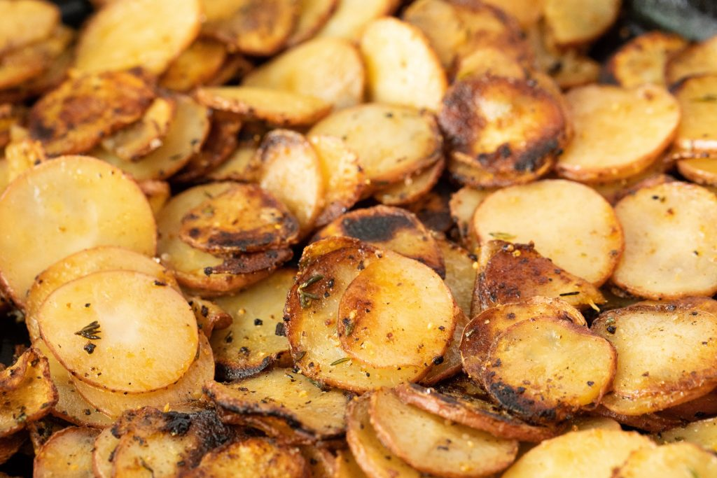 cooked skillet potatoes with seasoning.