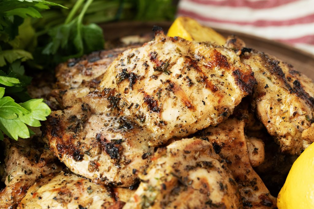 grilled boneless skinless chicken thighs with parsley and lemon.