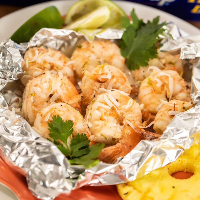 grilled coconut shrimp on foil packet.