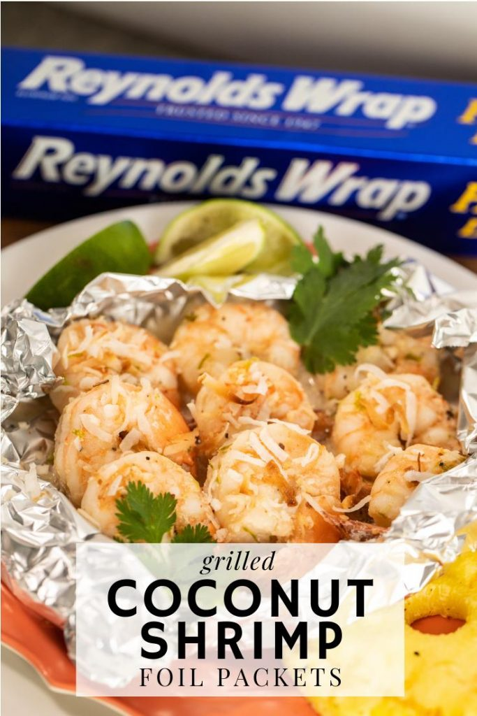 grilled coconut shrimp in a foil packed bowl in front of a box of Reynolds Wrap aluminum foil.