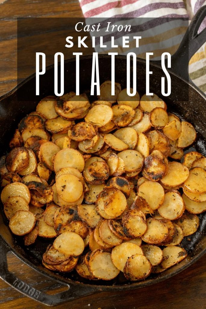 """grilled potatoes in a cast iron skillet. text overlay reads, """"cast iron skillet potatoes.'"""