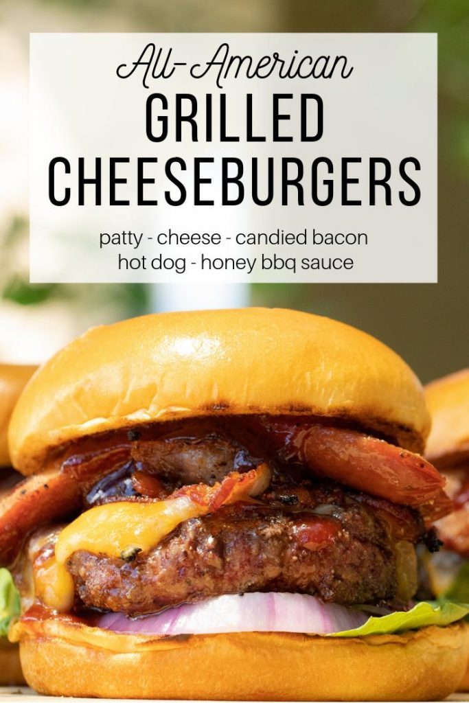 Grilled cheeseburger topped with sliced hot dog, cheese, onion, lettuce, and honey bbq sauce.