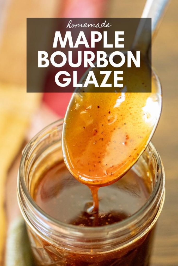 Maple bourbon glaze in a glass jar with spoon.