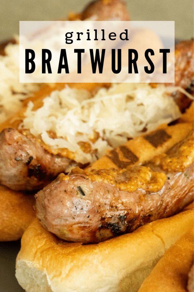 Grilled bratwurst in a bratwurst bun topped with mustard and sauerkraut.