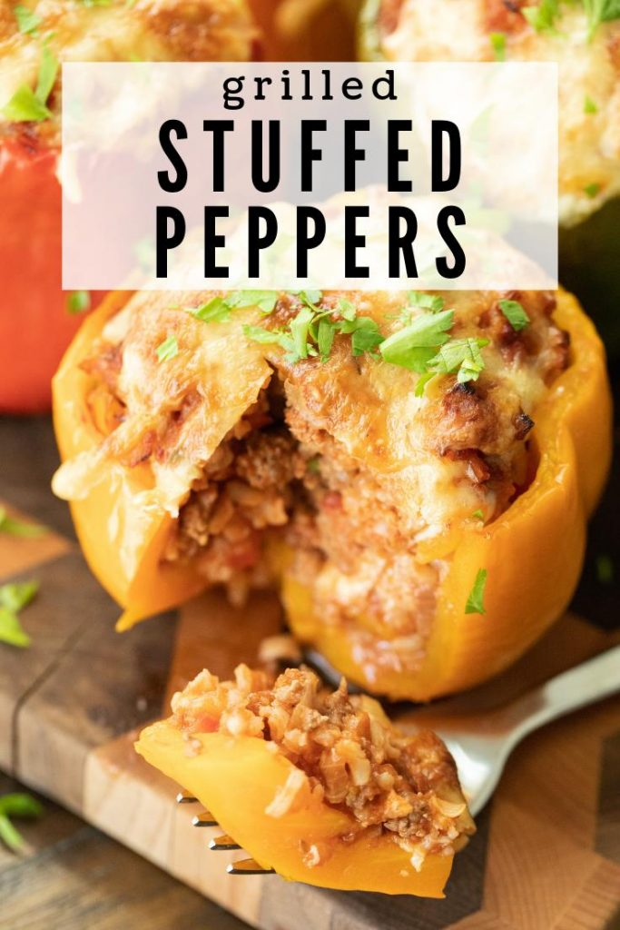 yellow bell pepper stuffed with meat and cheese. Slice cut out and resting on a fork.