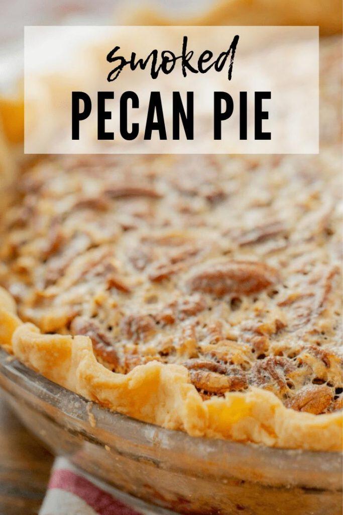 "smoked pecan pie in a glass pie tin. Text overlay reads ""smoked pecan pie."""