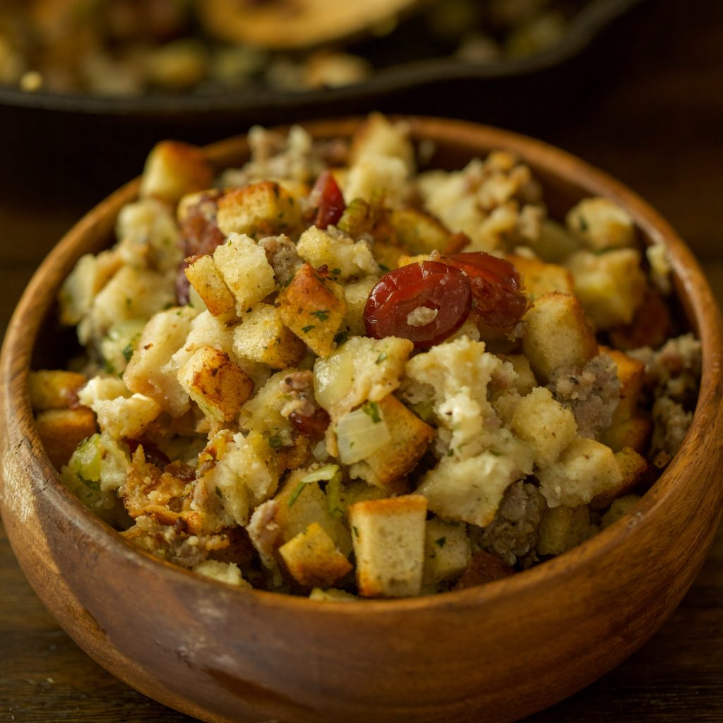 Smoked sausage stuffing in a wooden bowl.
