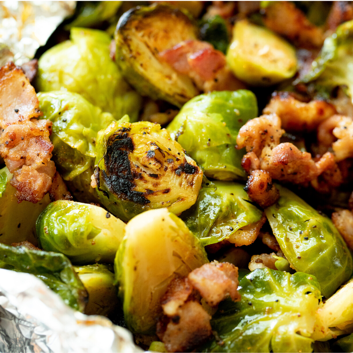 Close up of grilled brussels sprouts mixed with bacon.