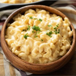 Wooden bowl of smoked gouda mac and cheese.