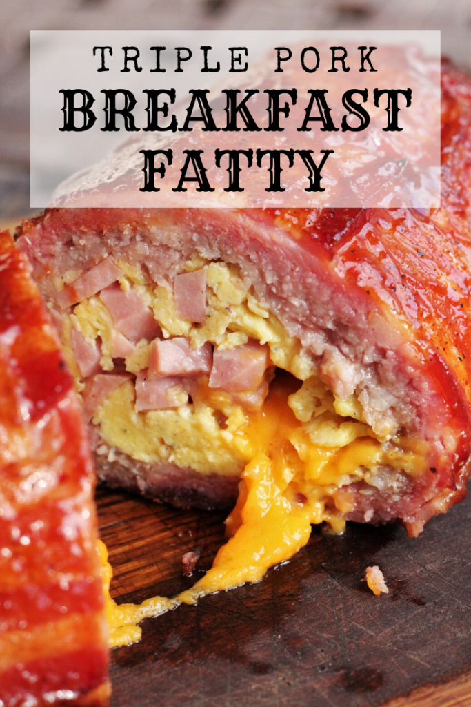 breakfast fatty cut in half showing the insides on a wood cutting board.