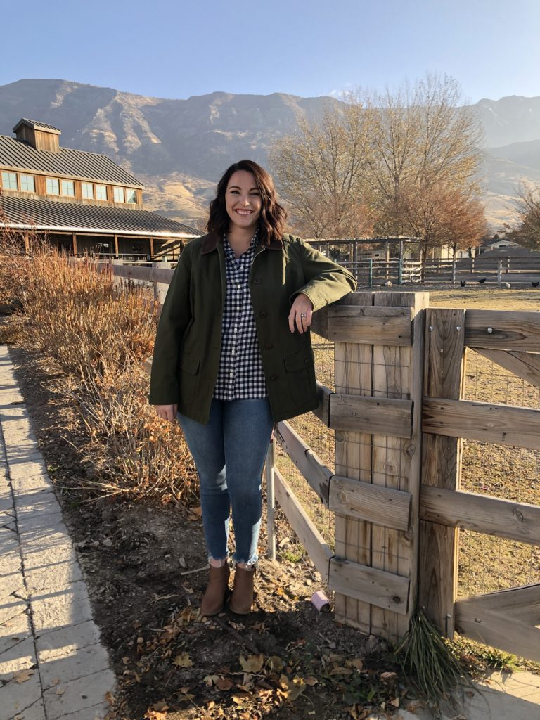 Susie Bulloch poses against a railing on a farm in Lehi, Utah.