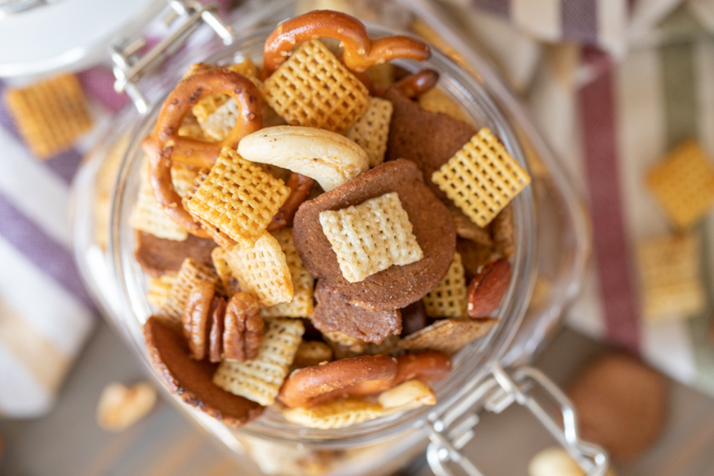 Overhead shot of smoked Chex mix in a hinged glass mason jar.