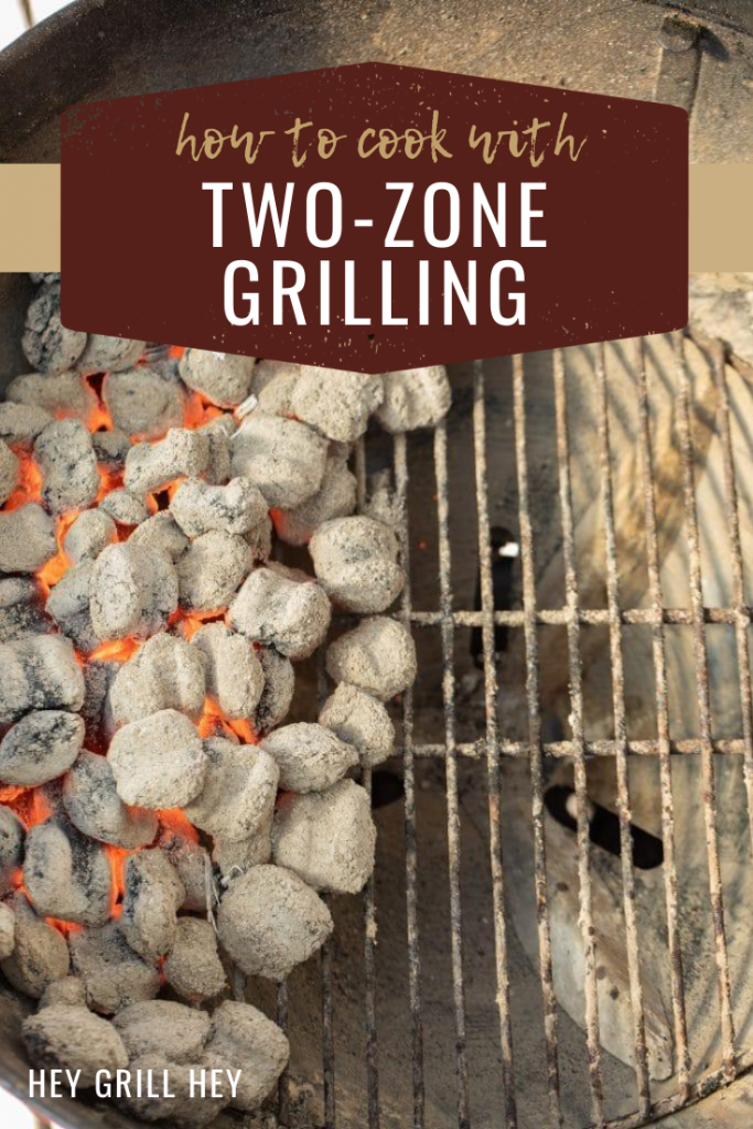 Hot charcoal spread over half a circular grill with text overlay that reads: How to cook with two-zone grilling.