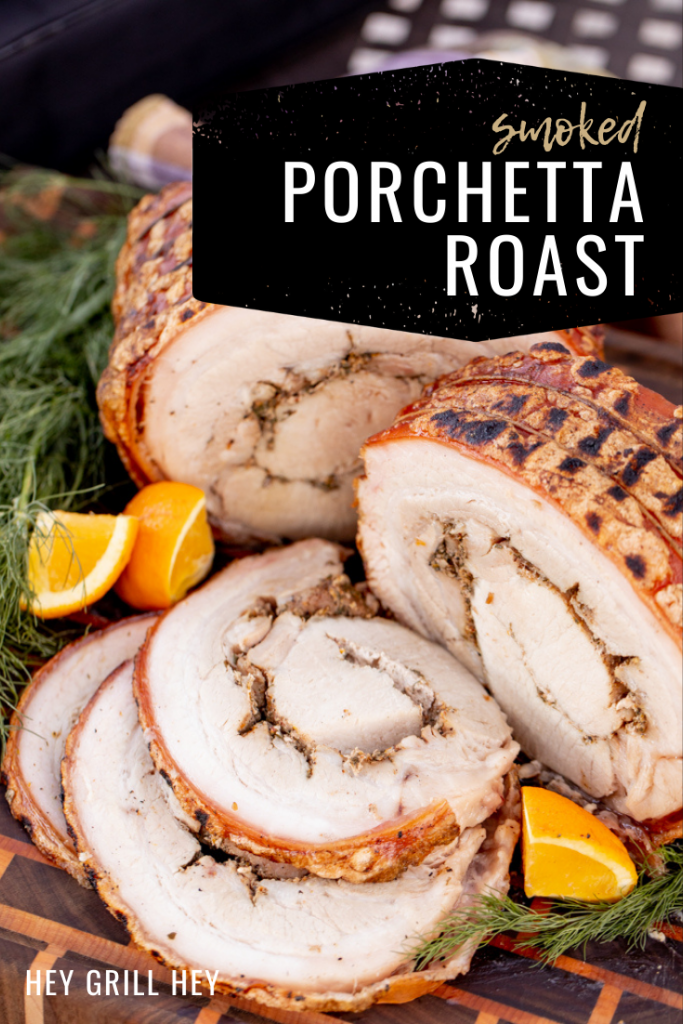 Sliced porchetta surrounded by lime wedges and fresh herbs on a wooden cutting board. Text overlay reads: Smoked Porchetta Roast.