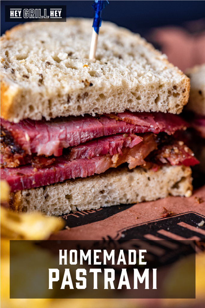 Homemade pastrami sandwich on peach Hey Grill Hey butcher paper. Text overlay reads: Homemade Pastrami.