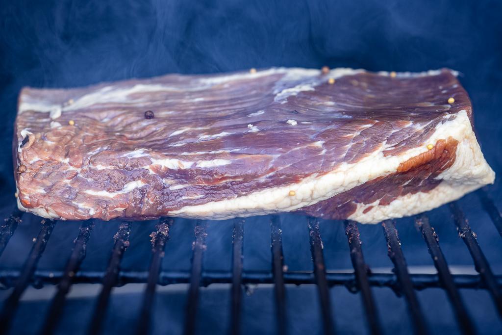 Seasoned pastrami on the smoker.
