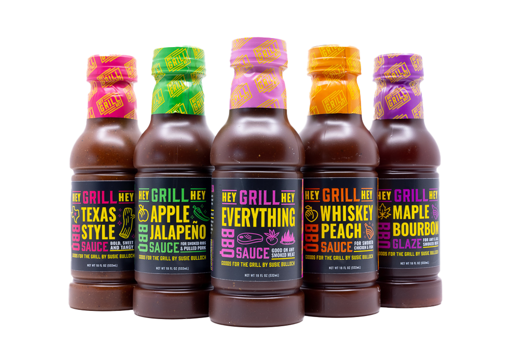 Five Hey Grill Hey sauce bottles lined up.